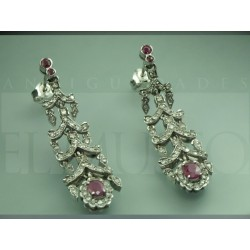 White gold earrings with rubies.