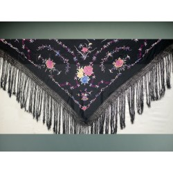 Black shawl embroidered in colours