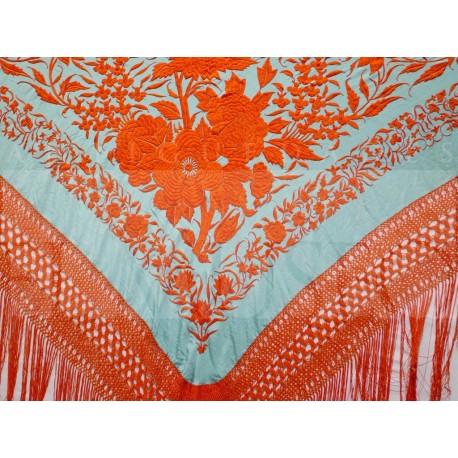 Mantón turquesa bordado en naranja