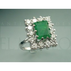 Emerald ring surrounded by diamonds